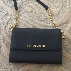 Michael Kors crossbody wallet on a chain